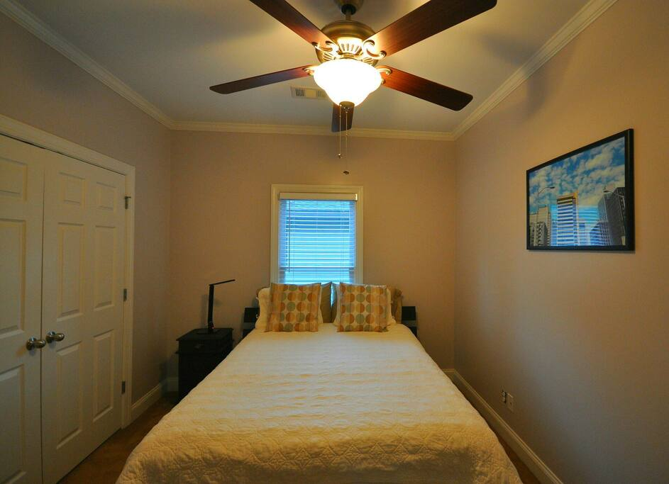 Super comfy Serta queen mattress and ceiling fan in your Atlanta-decorated cozy room.