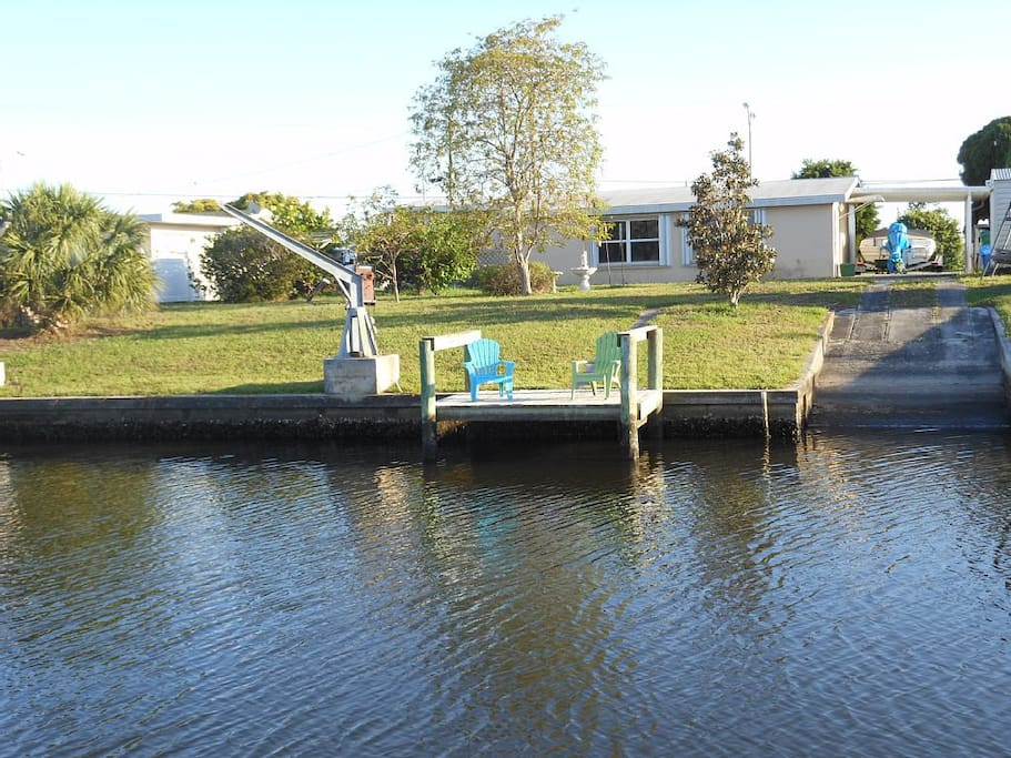 Waterfront, dock, and our own boat launch. CANOE INCLUDED FREE for your stay!  Enjoy coffee on the dock and watch the fish jump or the eagles land.  We have a little blue heron who visits every single day.