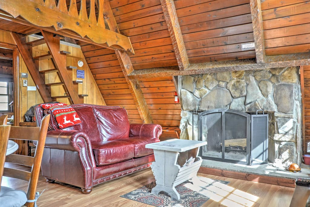 Warm your toes by the stone fireplace in the living area.