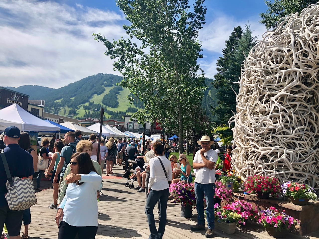 Farmers Market bustling with delicacies during Summer.  Snow King mountain in the background.  This is your world class location during your stay!