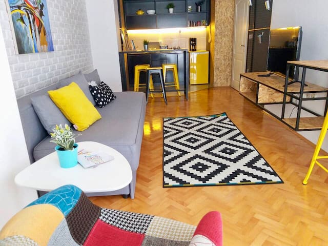 Cozy and stylish living room + kitchenette