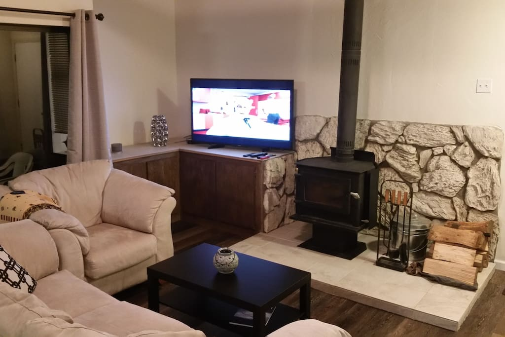 """Wood stove and 55"""" TV with Goolge Home (stream from your device to TV) in Living Room"""