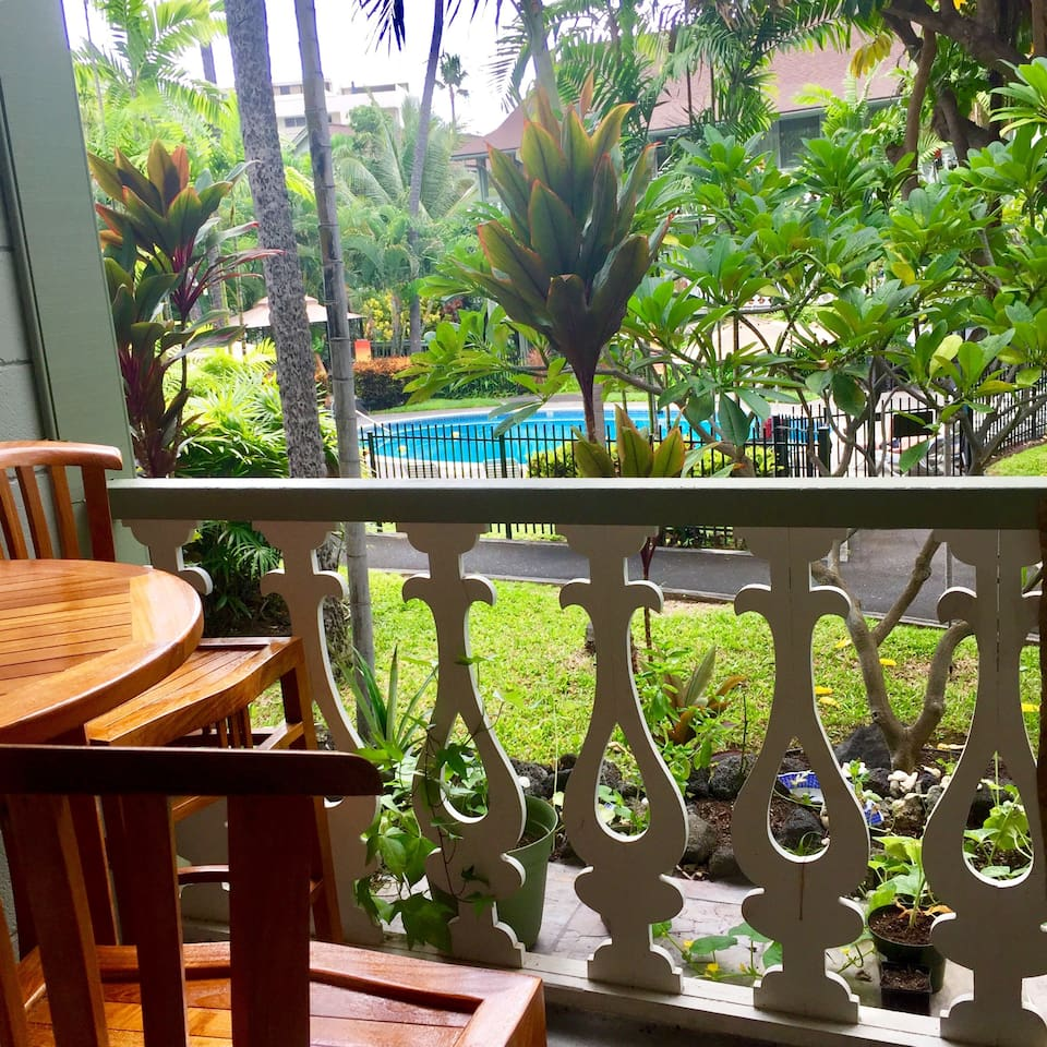 Enjoy breakfast outside on the lanai overlooking the lush garden surroundings and pool in the distance.