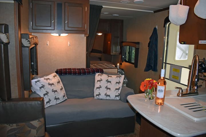 Plenty of room to lounge inside on a comfy couch with the bedroom in behind. Couch pulls out into a bed.