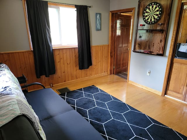 Bedroom 1 Futon that converts to full size bed  Dart board