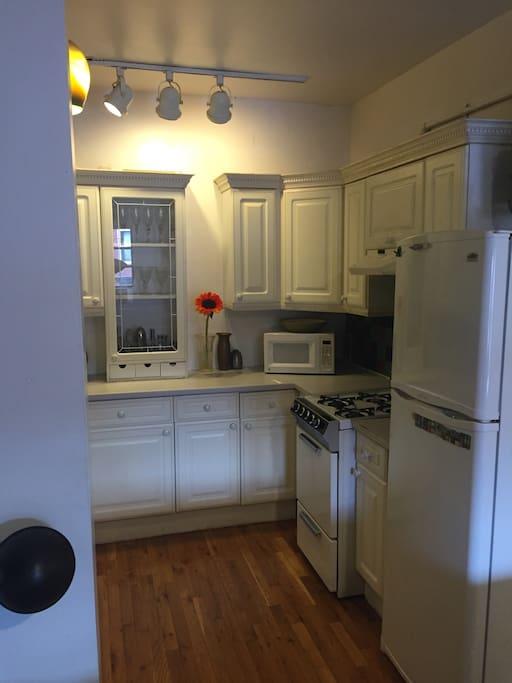 Kitchen has full refrigerator, microwave oven, gas stovetop and oven, dishwasher and everything you need.