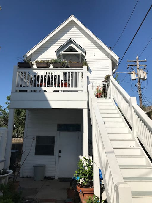 Carriage house apartment is accessed via exterior staircase shown in photo.