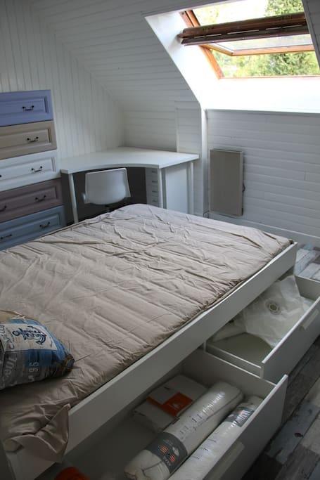 Storage space below the bed