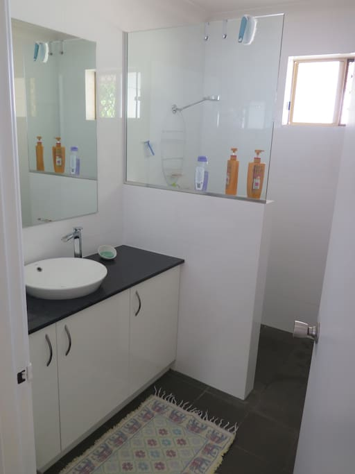 Shared bathroom, has ventilation and heat lights