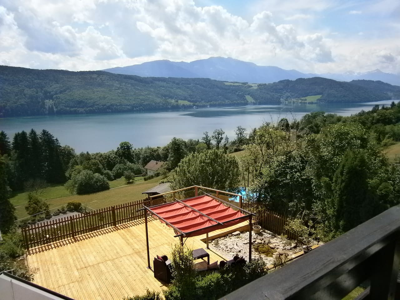 Outlook across lake Millstättersee from the private Balcony. The Balcony is a comfortable space with table & chairs. Creating a comfortable space to enjoy a meal, a book, a drink ...