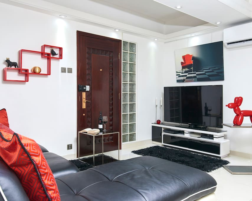 A lovely living room with L-shaped sofa where you can watch your favorite TV shows.