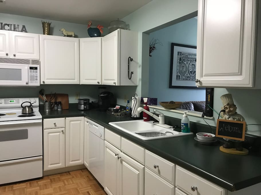Fully-stocked kitchen with table for four