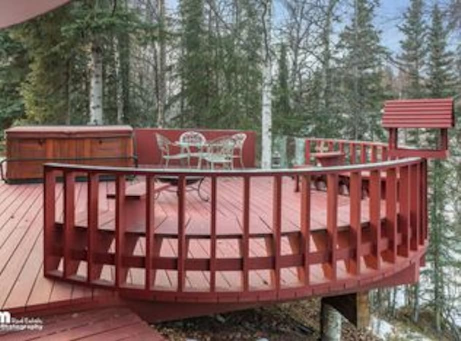 Enjoy the large deck, gas BBQ grill and hot tub just above Burning Bush Creek