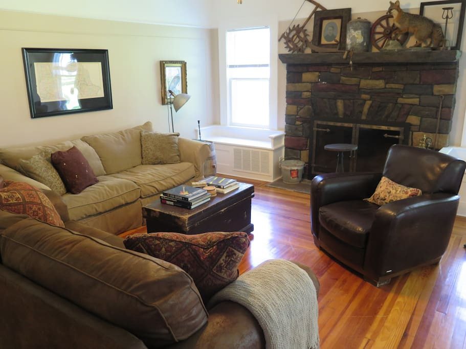Walk in the front door to our cozy living room... complete with original hardwood floors, fireplace and queen size sleeper sofa.