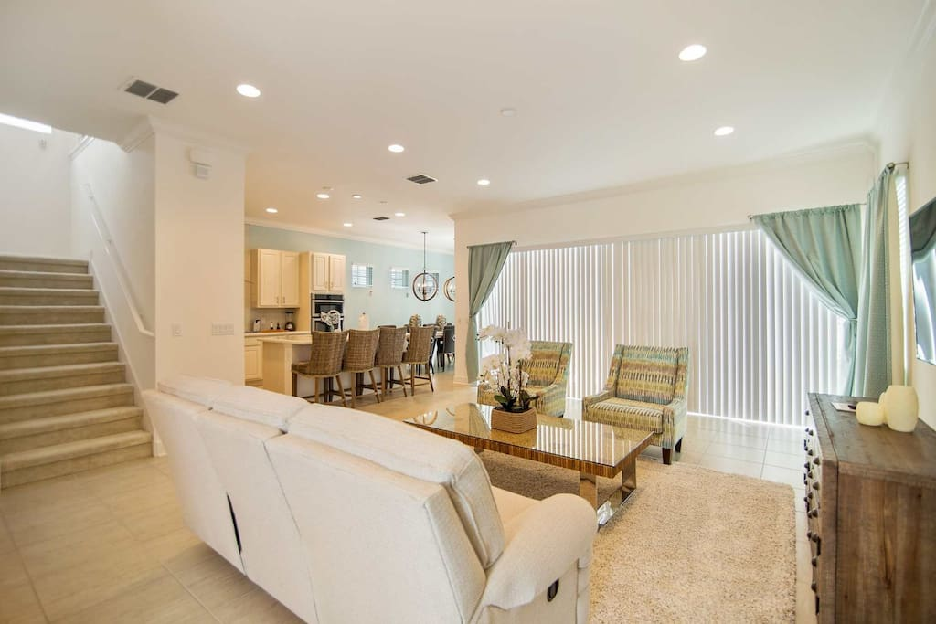 Beautiful Open Floor Plan Living Area, Dining Area, Kitchen and Pool Access