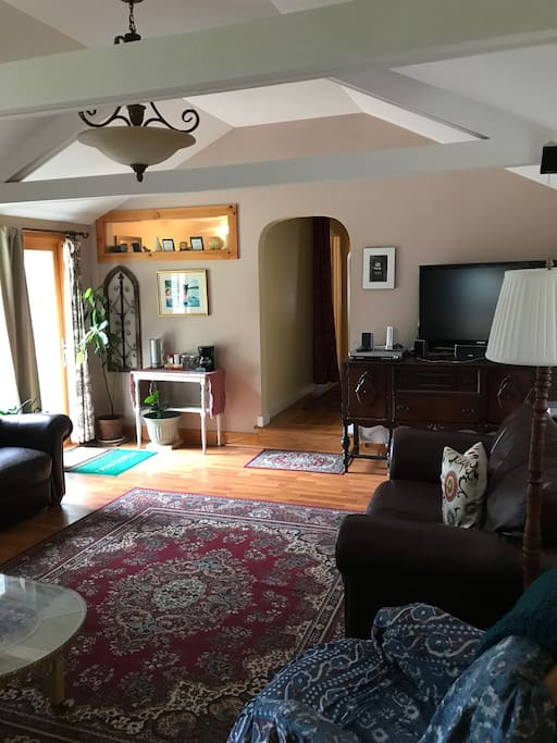 Living room looking to sliding glass door entrance.
