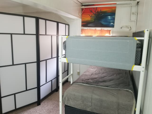 Twin Bed or Couch Basement Hostel Setting