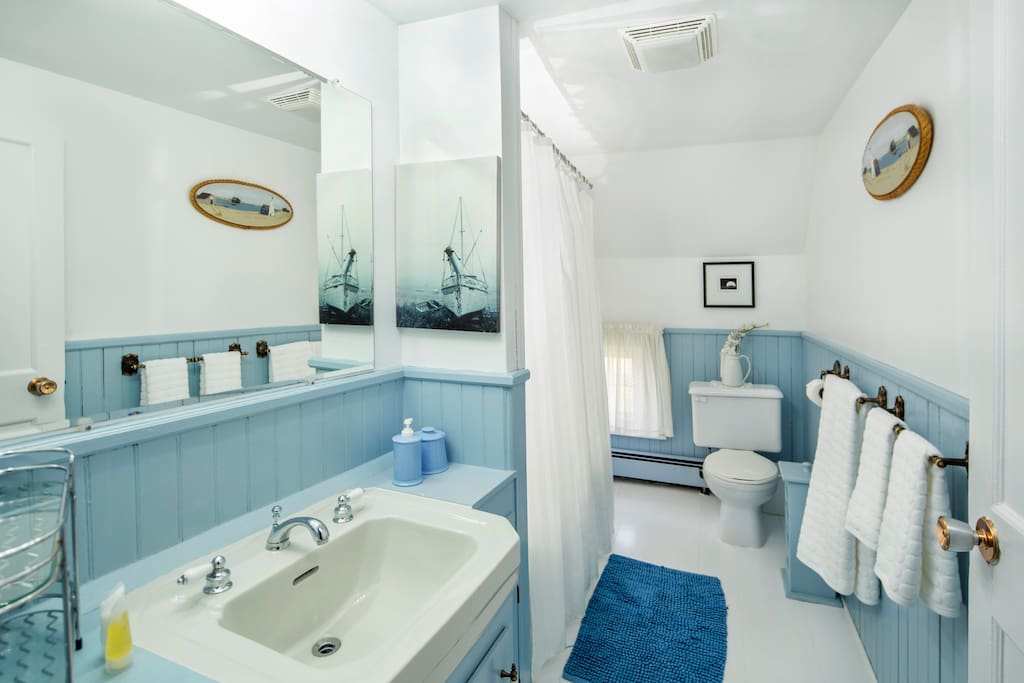 A bathroom that is across the hall and is shared with a smaller room which will soon be announced on airbnb.