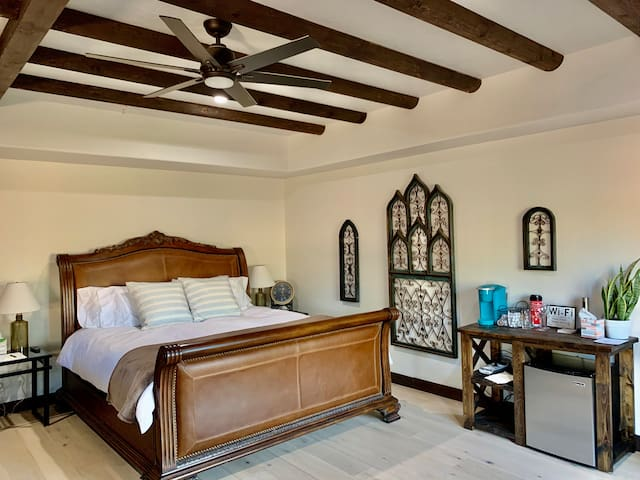 Ultimate comfort ~ King size bed with plush, clean linens  & coffee bar with mini fridge and wine cooler