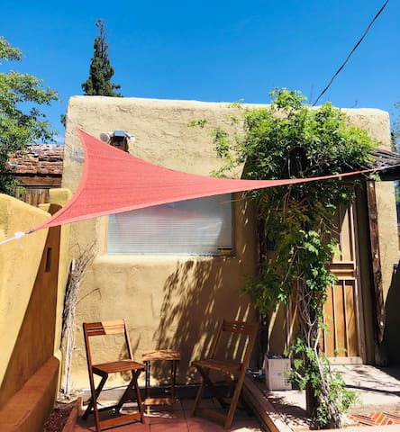 Ruthie's Place is a small home in the heart of the city with a front and back porch, record player, flat screen television complete with Netflix/Amazon/Hulu subscriptions, a kitchen that's a little larger than an efficiency, and historic charm
