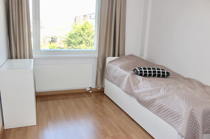 Bedroom 2: A single bed with under bed (2x90x200cm) where 2 adults (or children) can comfortable sleep. Blackout curtains keep the morning light out.