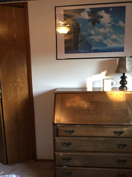 Desk, 3 lamps, and lock for the  bedroom door make this room safe and perfect for a work space!