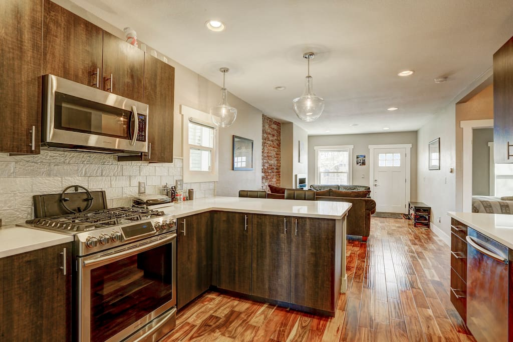 Stainless Steel Appliances and Floating Lighting.