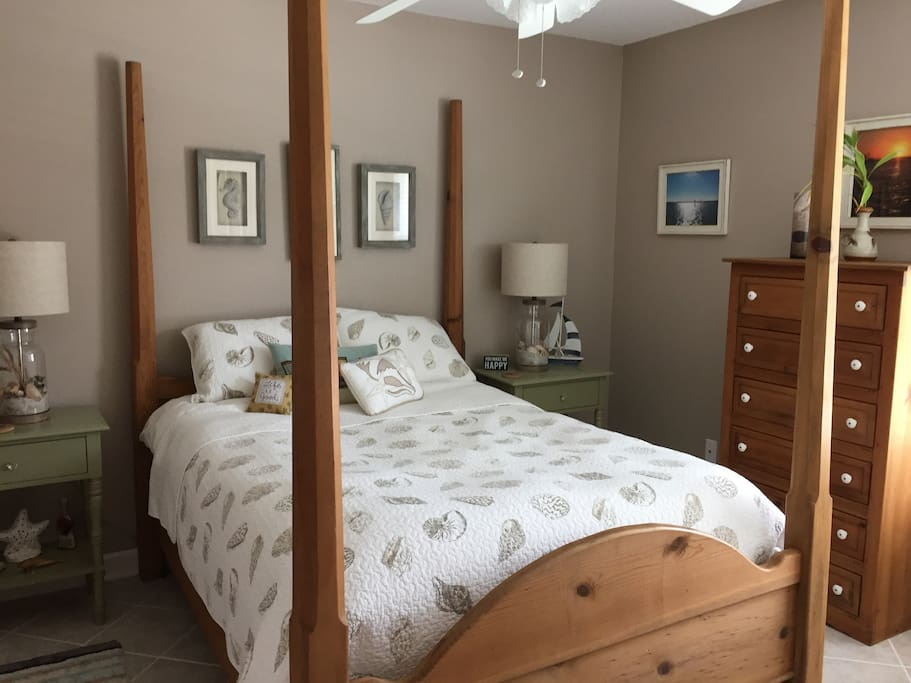 Nautical style bedroom with a comfortable full sized bedroom for one guest. A pocket door shuts off this bedroom and the bathroom from the living room for additional privacy.