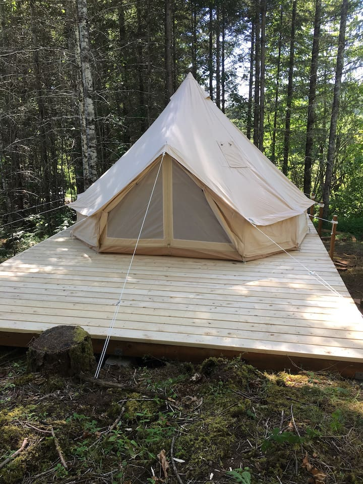 Privacy and comfort in the woods. The bell tent is a short walk from the communal areas.