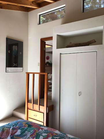 Stairs, built-in shelves and closet in 2nd bedroom w/vaulted ceiling