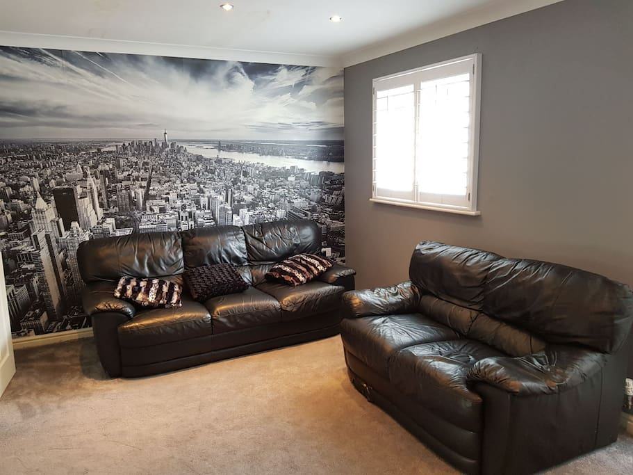 Living room with 3 and 2 seater  leather sofa , TV and Sky Q Box