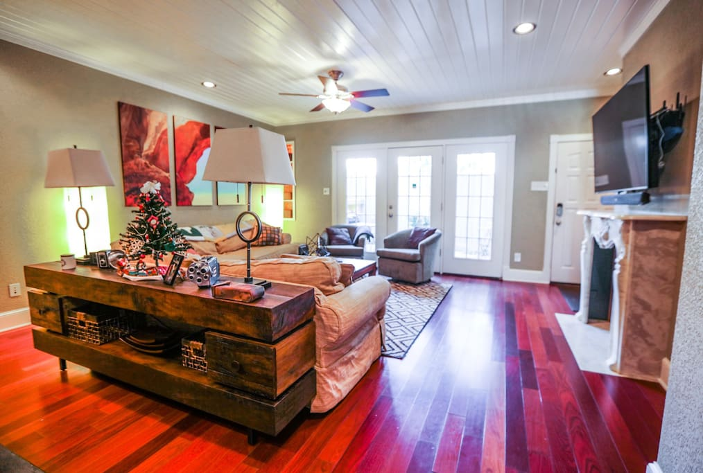 Another angle showing off the high-style this town home boasts. The elegant furniture & top of the line technology mesh well in this space. Surf the Internet with Ultra High-Speed Internet at 250mbps and jam to your favorite music via Bluetooth or AUX cord on the TV's Sound Bar / rear Sub-Woofer