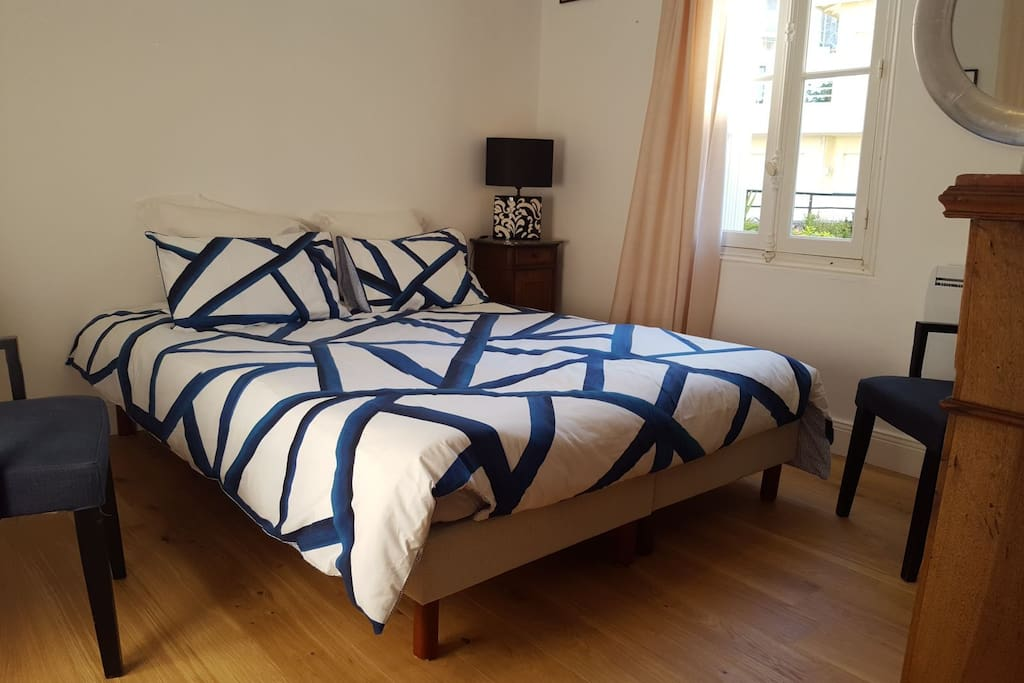 A very comfortable real King size bed fitted with luxurious bedding. The bedroom has an Aircon for hot summers and double core heater in winter