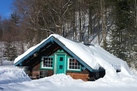 nature et aventure - Trois-Rives - Blockhütte