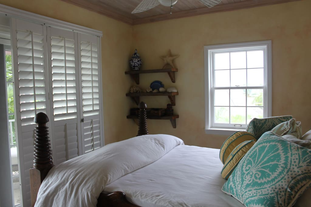 Upstairs bedroom with balcony access.