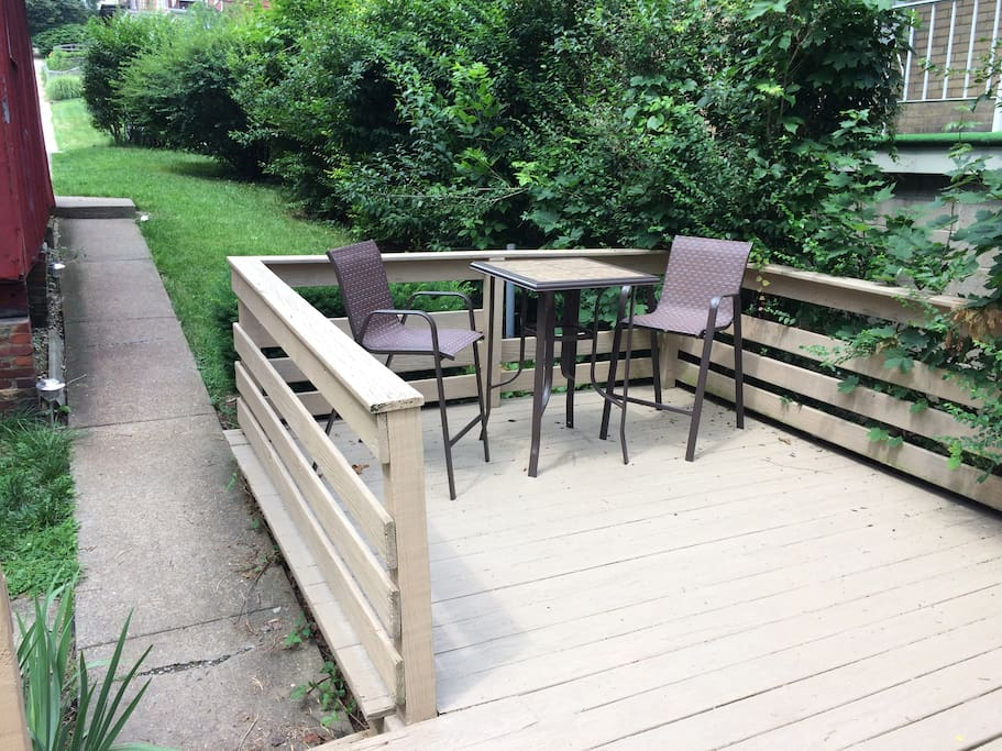 This is the sidewalk to the house and  front deck.  Enter the house from here.  Seating and grill are provided for you to enjoy.  Ashtrays are located in this designated outside smoking area.