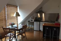 Loft kitchen area and dining table.  If you feel like cooking their is hot plates available for cooking on.