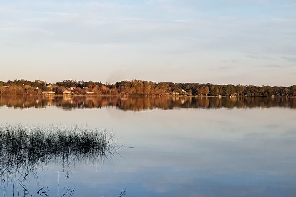 Sun beginning to set, beautiful reflection across the lake