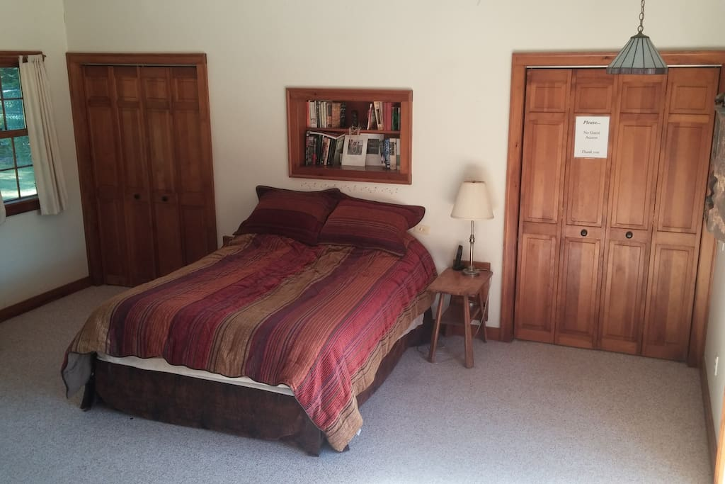 The master bedroom is spacious with large walk-in closets
