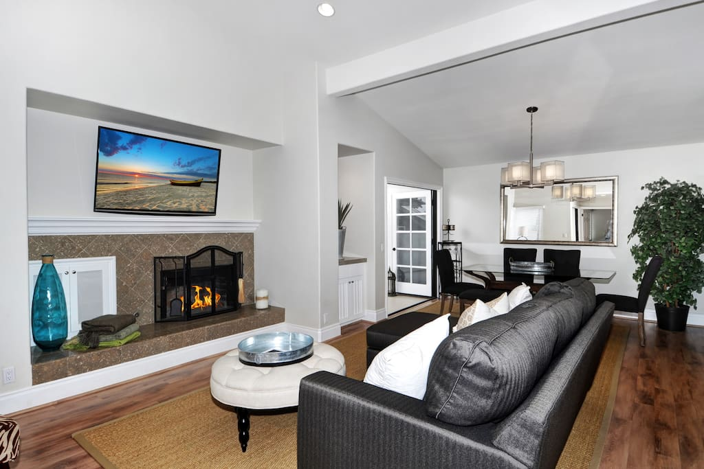 Light and bright open living room with vaulted ceilings