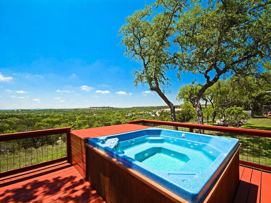 End your day with your favorite cold drink and some country-style stargazing while relaxing in the hot tub with views of the Texas Hill Country, only minutes from Austin, Texas.