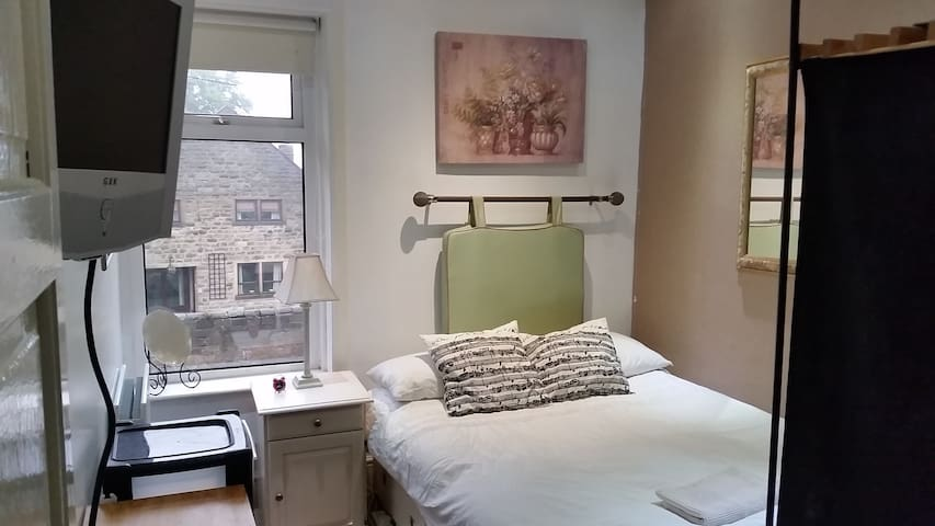 Room 4, with double bed and shared bathroom shower