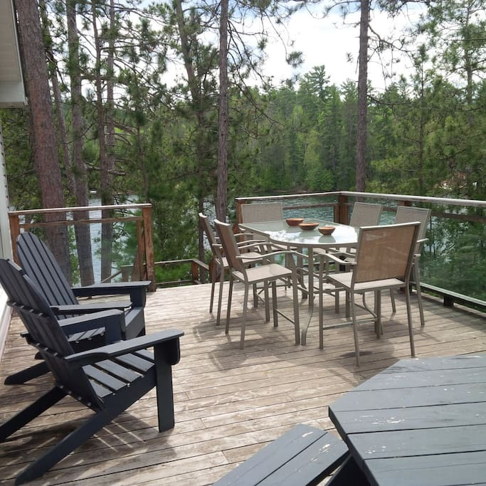 The deck off of the kitchen with plenty of seating, gas and charcoal BBQs
