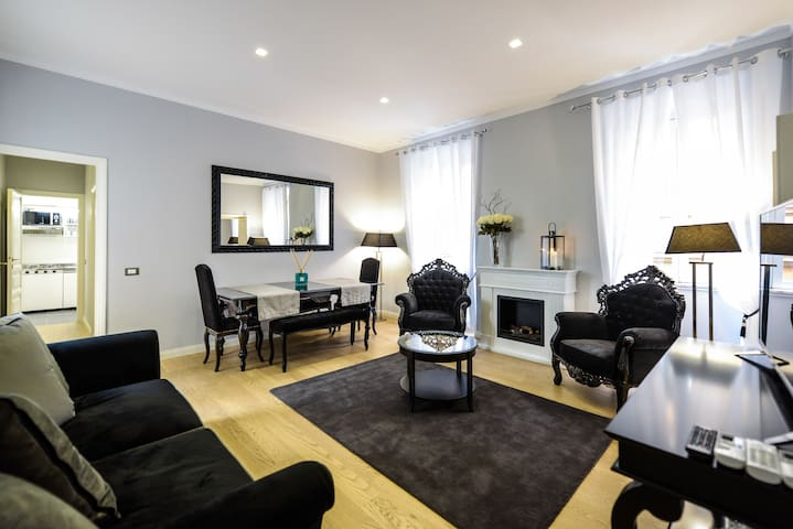 Living room with sofabed and dining area