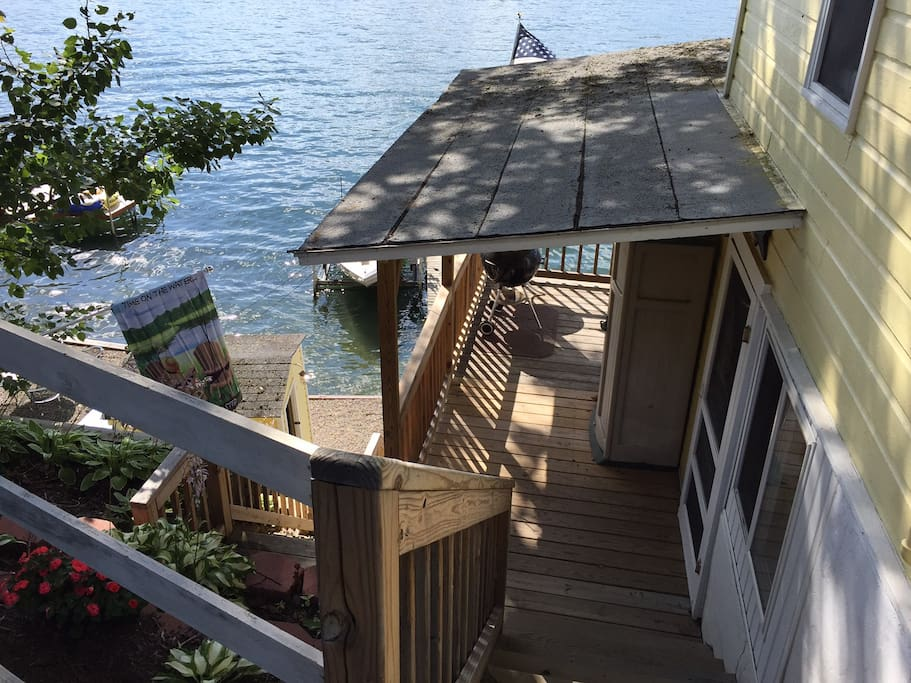 Steps down to side entrance (kitchen & living area) and deck.