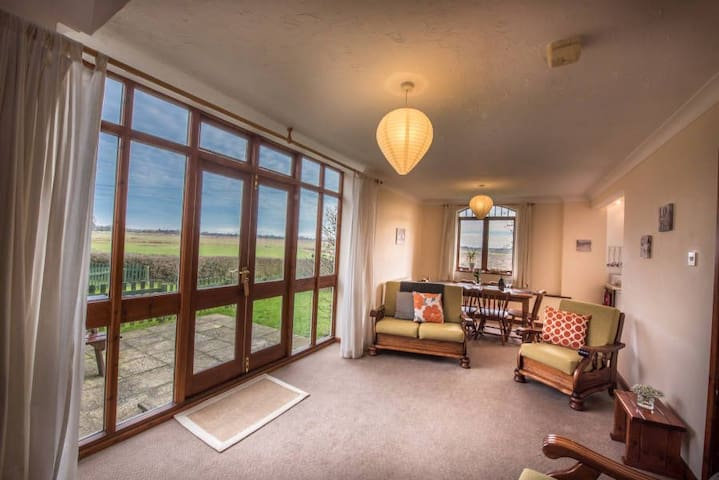 A spacious three bedroom, two bathroom cottage, suitable for up to 6 people.