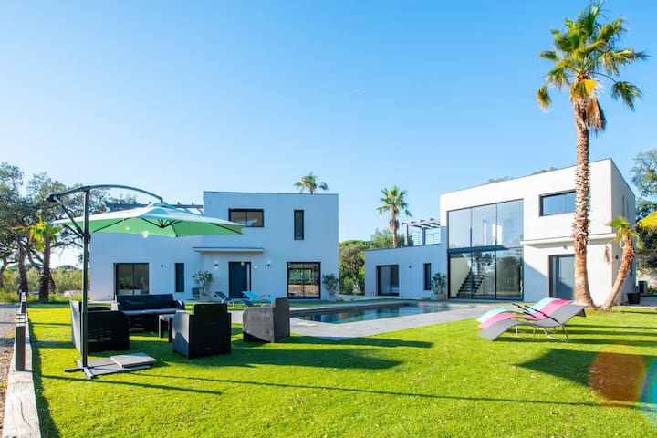 Two magnificent villas with a swimming pool, garden & central AC!