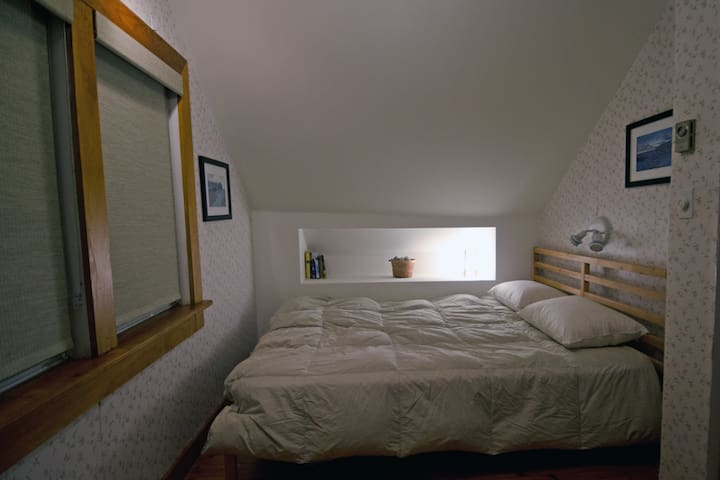 The second bedroom upstairs is smaller, but has a gorgeous view out to the islands... again, without leaving the bed!