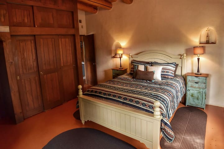 The casita on the weimer compound guesthouses for rent in taos queen bedroom glowing with natural light and southwest charm solutioingenieria Images