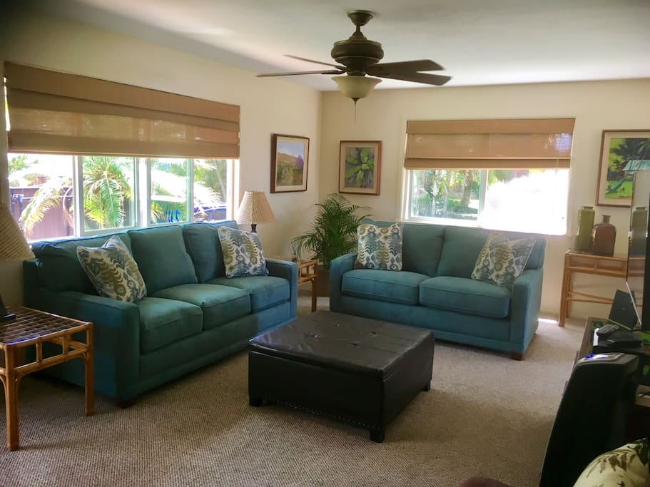 Living room w/ lot of seating with partial ocean views